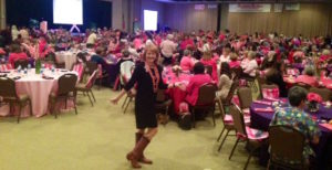 Breast cancer survivor speaker Susan Sparks in her cowboy boots -- and a sea of pink -- at CHI St. Luke's Health in Lufkin, TX